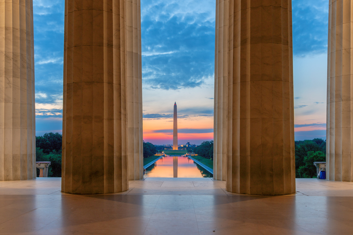 Sunrise view at Washington Monument and Reflecting Pool from Lincoln Memorial in Washington, D.C., USA.